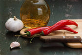 Garlic and red chili peppers — Stock Photo