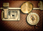 Old suitcase and compass — Stock Photo