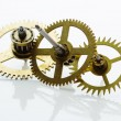 Clockwork gears on white — Stock Photo #23399676
