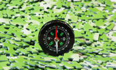 Compass on pile of green puzzle — Stock Photo