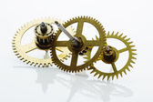 Clockwork gears on white — Stock Photo