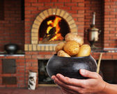 Cast iron pot with a potato in the hands in Russian cuisine wit — Stock Photo