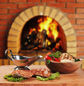 Dishes of roast meat in Russian cuisine with an oven and a bur — Stock Photo