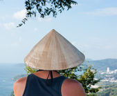 Thai man in the national hat looks at the sea — Stock Photo