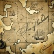 Old compass on a stylized map — Stock Photo #23998689