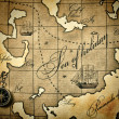 Old compass on a stylized map — Stock Photo