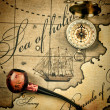 Old tobacco pipe and a compass on the map - Photo
