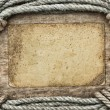 Royalty-Free Stock Photo: Frame made of twisted rope and old paper on a wooden background
