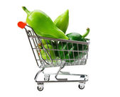Green sweet pepper paprika in shopping trolley isolated on whit — Stock Photo