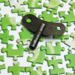 Key on the green puzzle — Stock Photo
