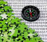 Puzzles and compass on a binary code — Stock Photo