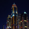 Dubai Marina at night - Stock Photo