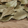 Dry bay leaf on old wooden board — Stock Photo #24314247