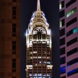 Night view of the Chrysler building in Dubai - Stock Photo