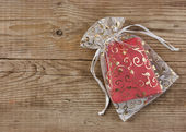 Christmas gift box on the old wooden background — Stock Photo