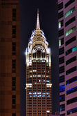 Night view of the Chrysler building in Dubai — Stock Photo