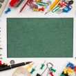 Frame from a variety of office supplies and green paper for note — Stock Photo