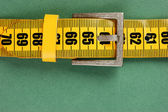 Meter belt slimming on the green background — Stock Photo