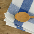 Stock Photo: Wooden kitchenware and dishcloth on old wooden table