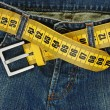 Stock Photo: Jeans with meter belt slimming