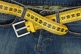 Jeans with meter belt slimming — Stock Photo