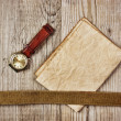 Vintage paper and old broken watch on wooden boards - Stock Photo