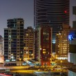 Постер, плакат: Nigh view of the Dubai Marina district Greens