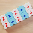 Educational blocks with math problems on the table - Stock Photo