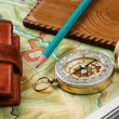 Royalty-Free Stock Photo: Compass wallet and passport on the old map