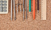 Stationery on the cork board — Stock Photo