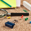 Office supplies in a mess on the table — Stock Photo #25195569