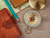 Compass wallet and passport on a wooden table — Stock Photo