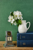 Old calendar and bird cherry branch in a jug on the wooden table — Foto de Stock