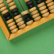 Old abacus on the green background — Photo
