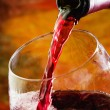 Red wine being poured into wine glass — Stock Photo #25395005