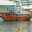 Old wooden boat in the Gulf in Dubai Marina - Stock Photo