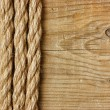 Frame made of rope on a wooden background — Photo
