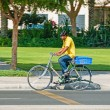 Arab man riding bicycle — Stock Photo