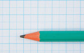 Drawing pencil on graph paper — Stock Photo