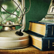 Old kerosene lamp and a stack of books — Foto de Stock