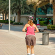 Roller skating woman on a Dubai street — Stock Photo