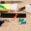 Office supplies in a mess on the table — Stock Photo #25927319