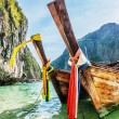 Traditional longtail boats in the famous Maya bay — Stock Photo #25927357
