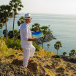 Stock Photo: Young min white suit on beach with map