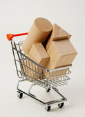 Wooden blocks for the construction in shopping trolley — Stock Photo