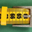 Stock Photo: Meter belt slimming on green background
