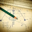 Stock Photo: Pencil and slide rule on old page with calculations in mechanics