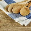Stock Photo: Wooden spoon and dishcloth on old wooden table
