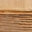Stock Photo: Edge of old newspaper on wooden background