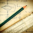 Pencil and a slide rule on the old page with the calculations in — Stock Photo